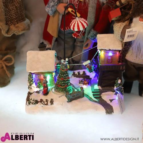 Villaggio Natalizio illuminato con babbo natale e slitte che si muovono