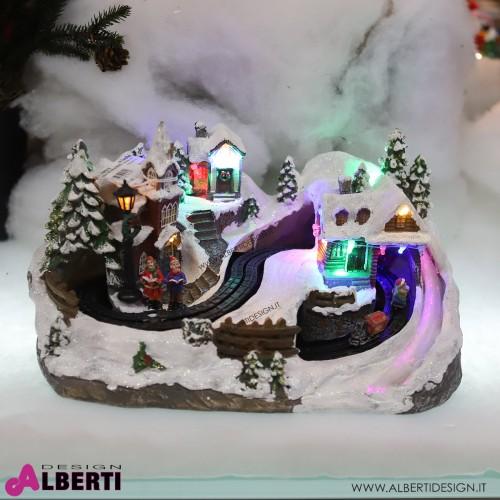 Paesaggio natalizio illuminato con musica e rotaie in movimento