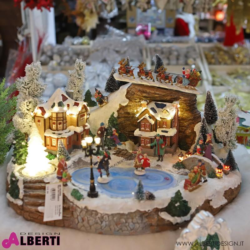 Villaggio invernale con luci suoni e pista con personaggi in movimento